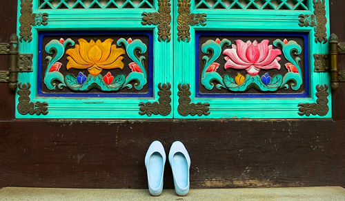 Photo of shoes outside a temple, South Korea